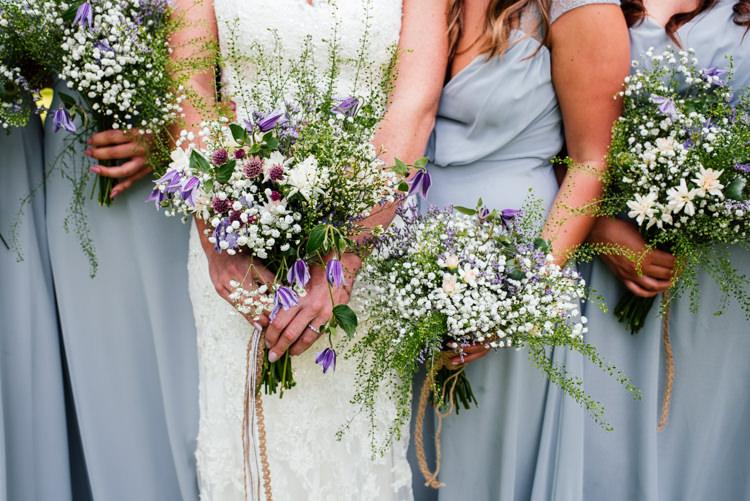 Wild Natural Bridesmaids Bouquets Flowers Bride Purple White Bridal Fun Loving Secret Garden Tipi Wedding https://www.aaroncollettphotography.co.uk/