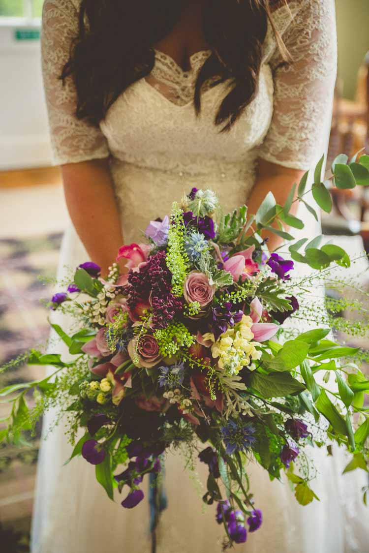 Bride Bridal Bouquet Multicoloured Rose Foliage Purple Pink Yellow Trailing Eclectic Floral Fun Wedding http://www.photographybypaloma.co.uk/