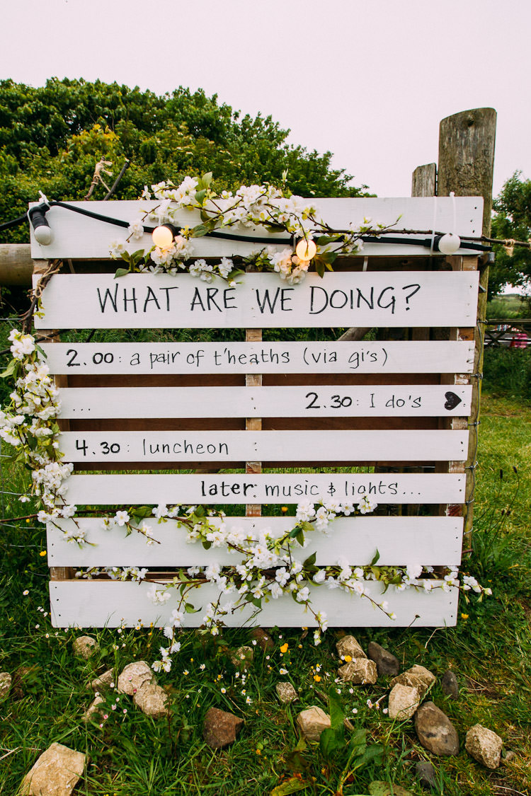 Pallet Sign Order of the Day Festoon Lighting Schedule Fun Laid Back DIY Rustic Marquee Wedding http://www.louisegriffinphotography.com/