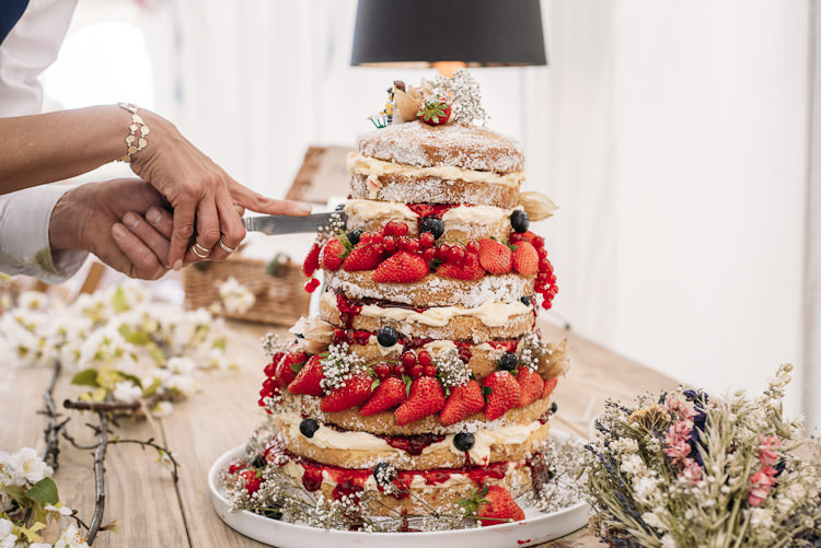 Naked Cake Summer Fruit Gypsophila Strawberries Fun Laid Back DIY Rustic Marquee Wedding http://www.louisegriffinphotography.com/