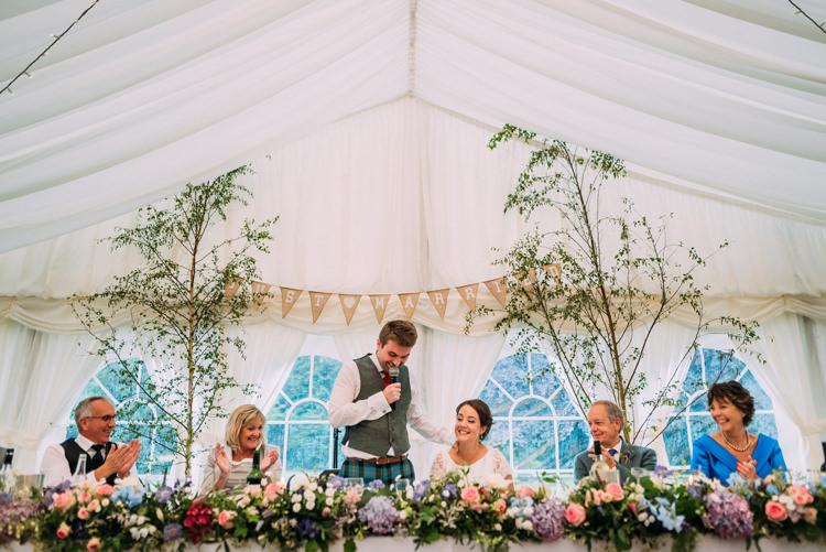 Top Table Flowers Garland Swag Trees Enchanting Cornflower Blue Marquee Wedding https://burfly.co.uk/