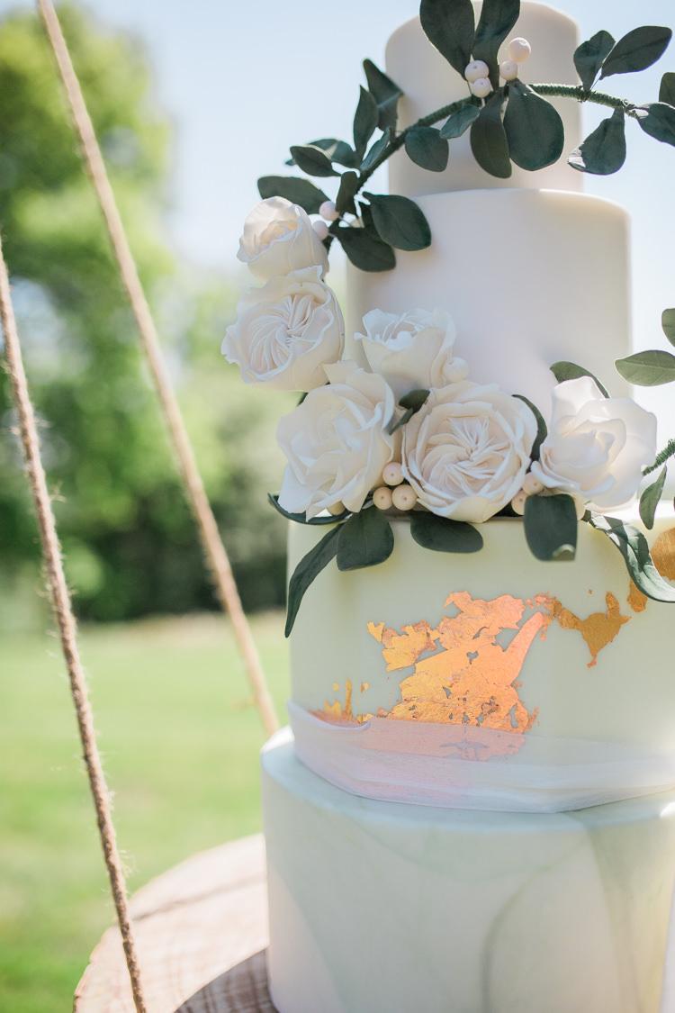 Marble Cake Wreath Gold Log Suspended Log Hanging Swing Bohemian Garden Greenery Wedding Ideas http://www.storytellerphotography.co.uk/