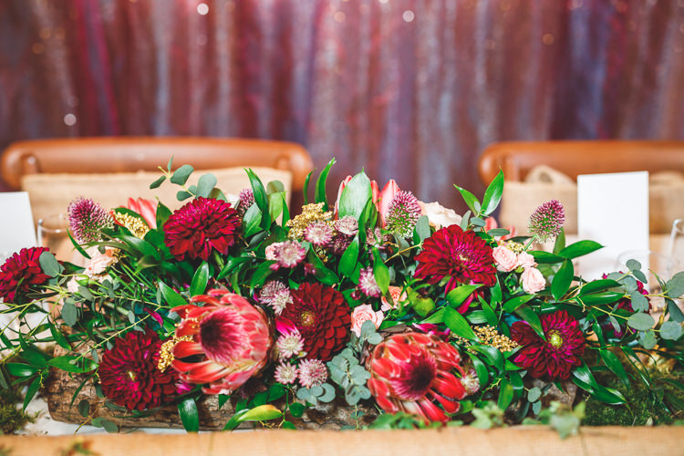 Top Table Dhalia Greenery Rustic Barn Red Gold Glam Wedding https://garethnewsteadphotography.com/