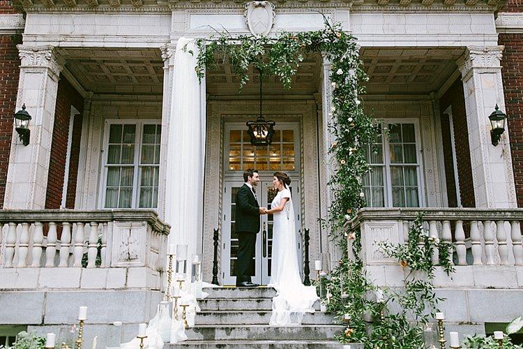 Bride Groom Steps Long Veil Plain Short Sleeved Dress Black Tie Gold Candles Greenery Modern Elegance Marble Greenery Gold Wedding Ideas http://www.jettwalkerphotography.com/