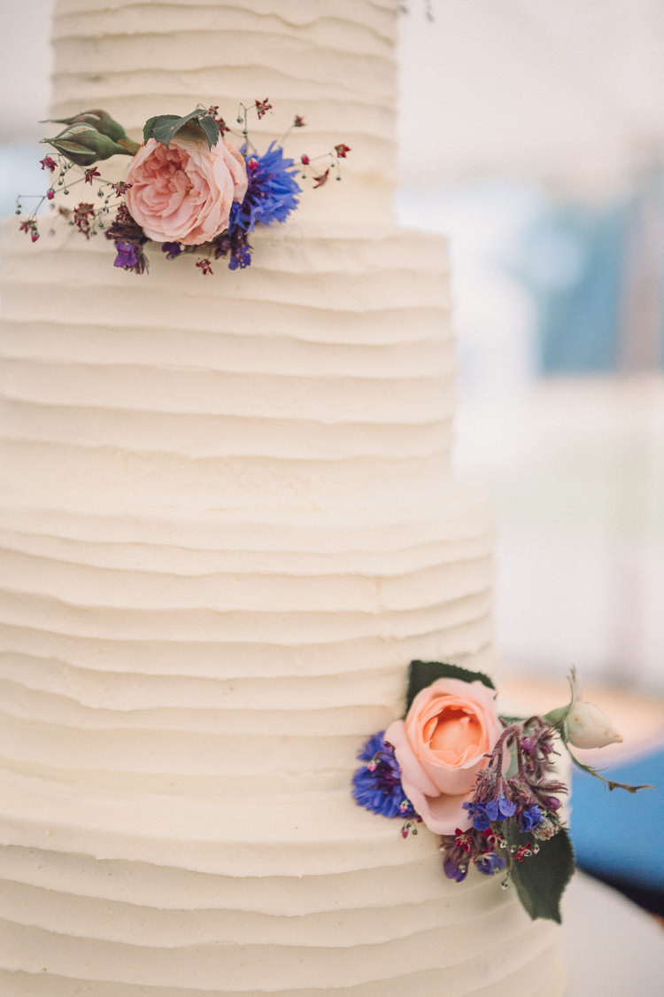 Buttercream Four Tier Cake Flowers Roses Relaxed Outdoor Marquee Farm Wedding http://www.jenniferjanephotography.co.uk/