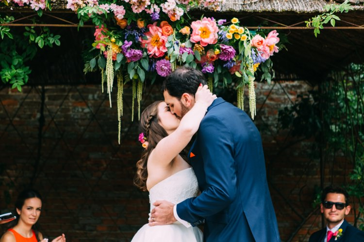 Flower Arch Backdrop Ceremony Peony Rose Colourful Mexican Garden Wedding http://jennifersmithphotography.co.uk/