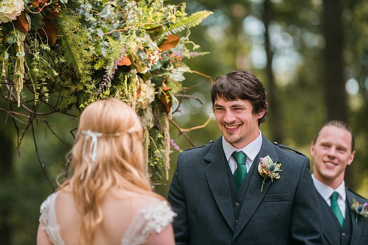 Bride Groom Ceremony Laughter Green Tie Thistle Buttonhole Bestman Outdoor Archway Foliage Whimsical Woods Wedding Barn Ohio http://www.connectionphotoblog.com/