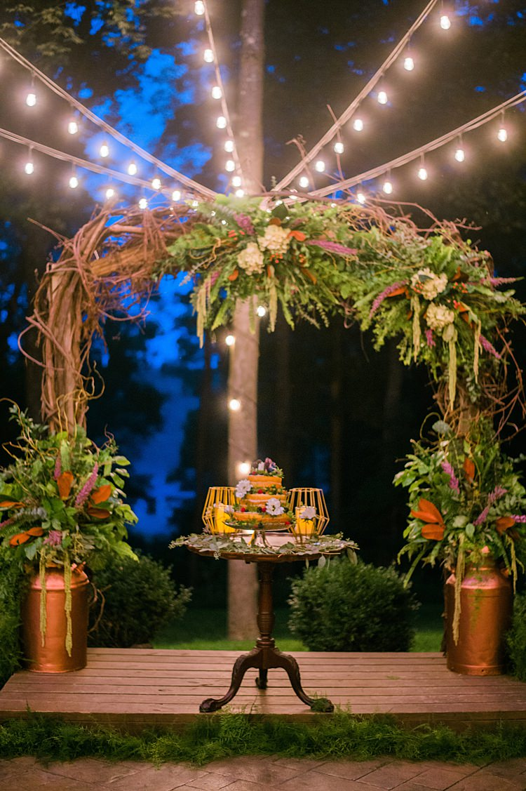 Festoon Lighting Cake Display Outdoors Archway Branches Whimsical Woods Wedding Barn Ohio http://www.connectionphotoblog.com/