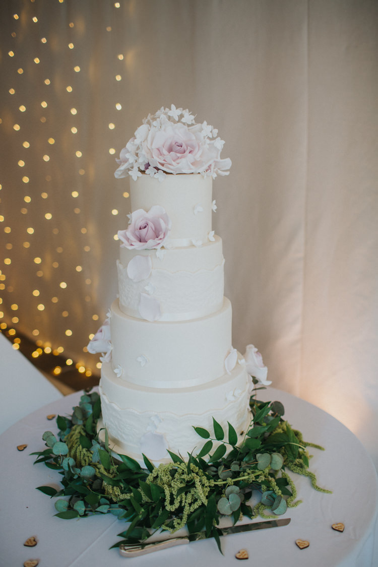Cake Classic White Icing Rose Greenery Four Tier Chic Romantic Florals Candlelight Wedding http://lisawebbphotography.co.uk/