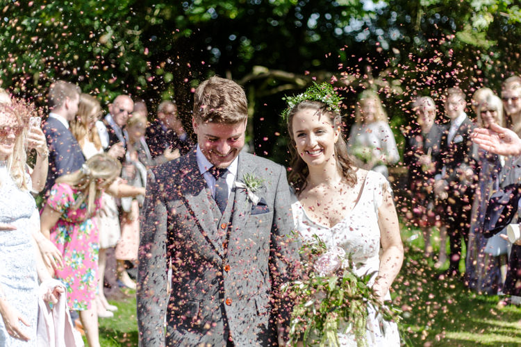 Bespoke Bride This Modern Love Bridal Greenery Foliage Hair Vintage Suit Groom Waistcoat Tweed Pocket Watch Chain Confetti Shot Moment Natural Outdoor Tipi Wedding https://www.ad-photography.co.uk/