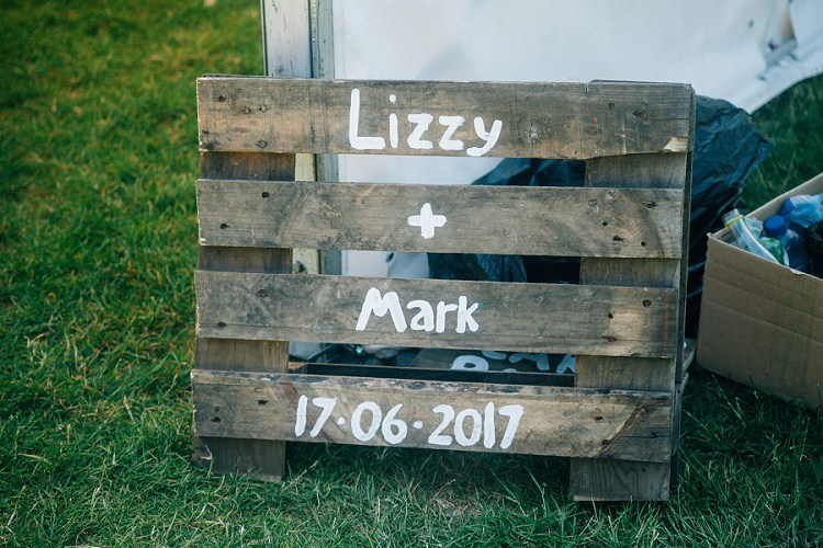 Wooden Pallet Sign Eco Friendly Floral Filled Wedding http://kellyjphotography.co.uk/