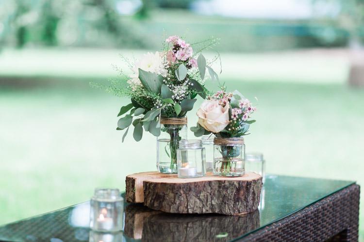 Jars Flowers Log Slice Simple Natural Honest Marquee Wedding https://www.gemmagiorgio.com/