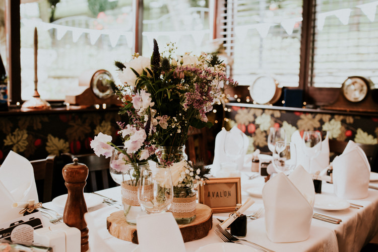 Jar Flowers Log Slice Table Decor Unique Personal Natural Wedding Style https://photo.shuttergoclick.com/