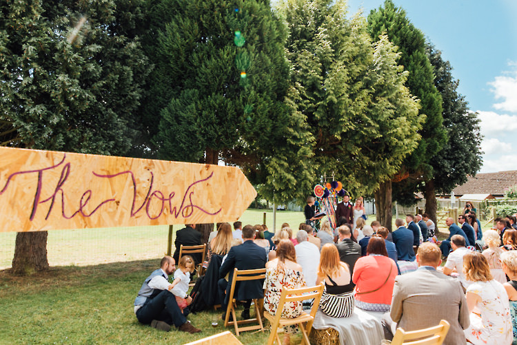 Wooden Sign Post Alternative Colourful Outdoor Humanist Village Hall Wedding http://www.chebirchhayesphotography.com/