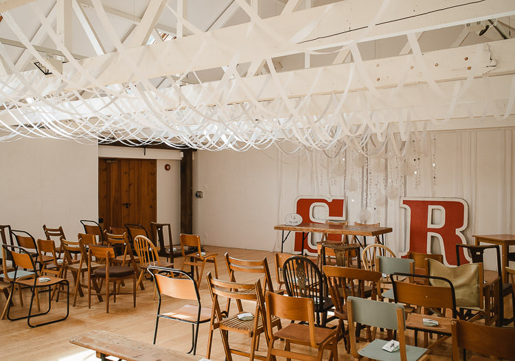 Streamers Ribbons Ceiling Hanging Ceremony Mismatched Chairs Super Cool Informal Party Wedding http://www.luisholden.com/