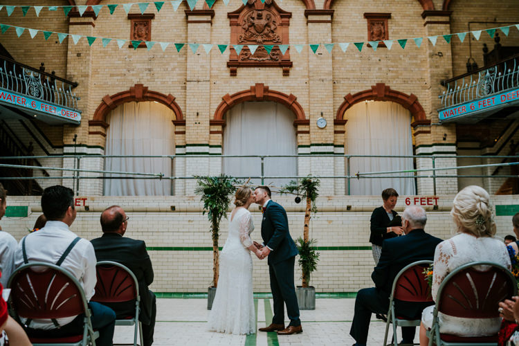 Backdrop Frame Wooden Greenery Ceremony Flower Arch Colourful Cool Humanist Pool Wedding http://www.stevebridgwoodphotography.co.uk/