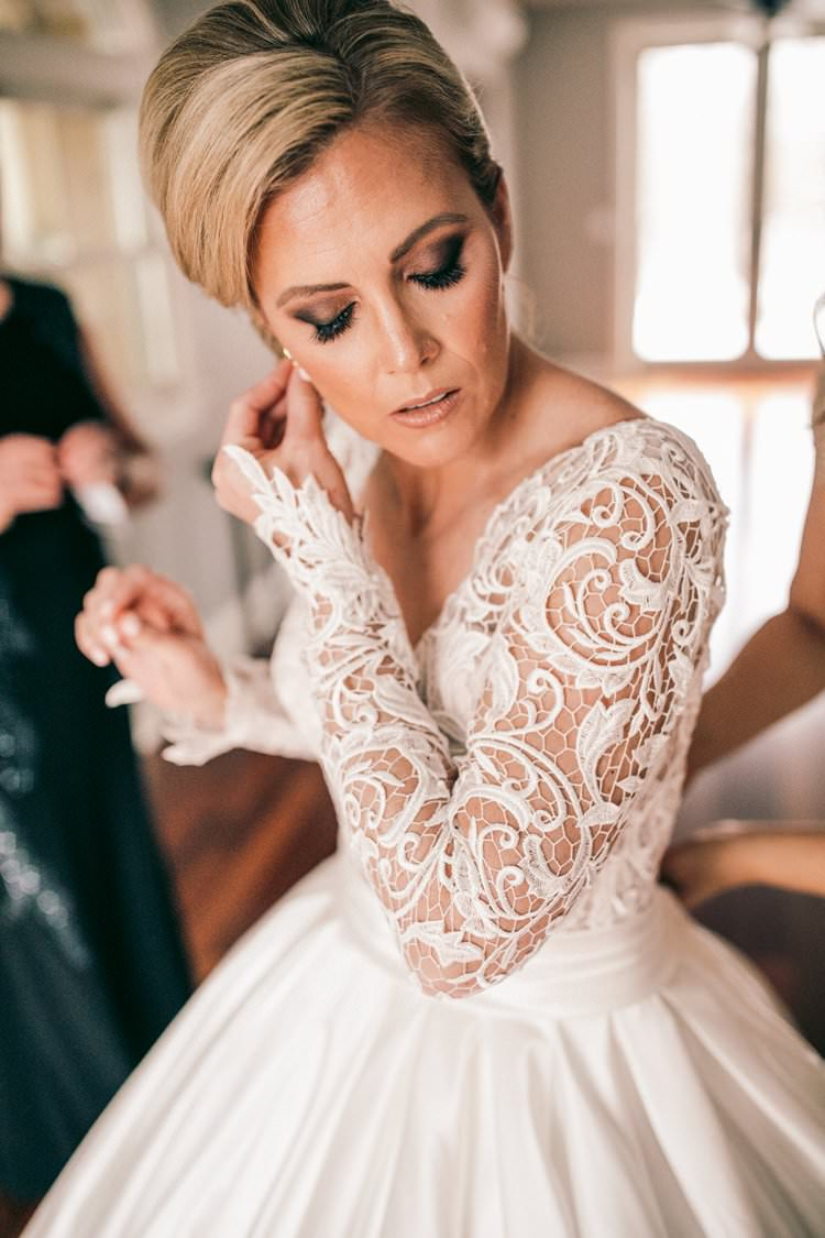Bride Lace Sleeves Winter Gown Romantic Updo Pnina Tornai | Festive Glamour Christmas New Years Eve Wedding http://www.stevendrayimages.com/