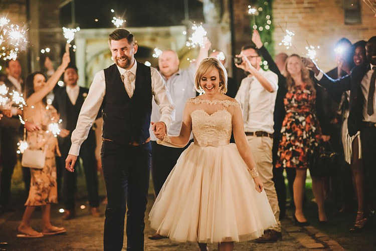 Sparklers Exit Untraditional Pretty Travel Barn Wedding https://www.georgimabee.com/