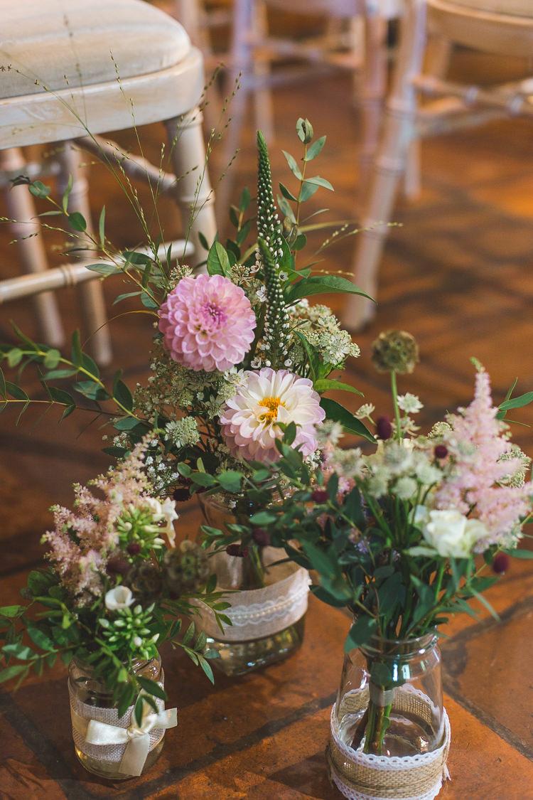 Aisle Flowers Jars Hessian Lace Pink Whimsical Romantic Barn Wedding http://kirstymackenziephotography.co.uk/
