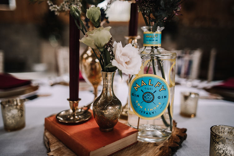 Centrepiece Decor Tables Books Flowers Bottles Candles Luxe Rustic Autumn Berry Wedding http://www.oobaloosphotography.co.uk/