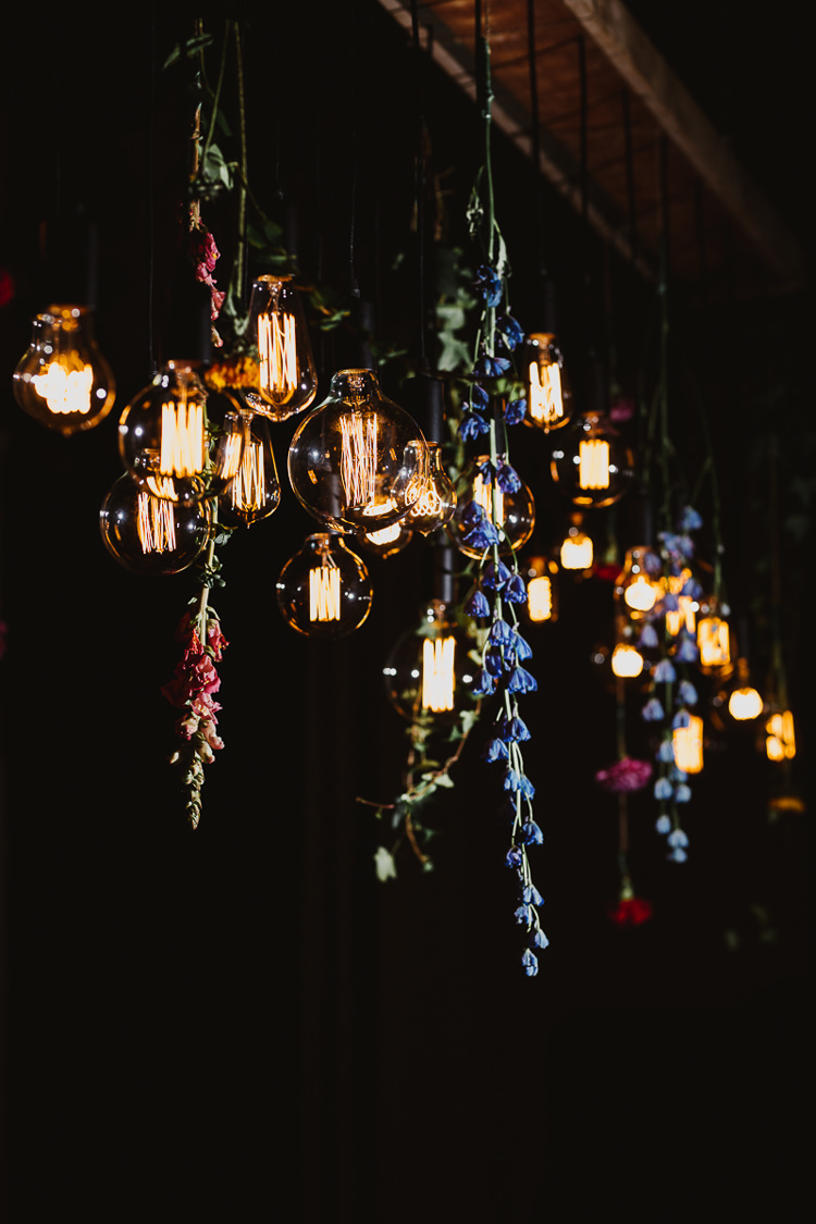 Edison Light Installation Hanging Flowers Colourful DIY Floral Luxe Barn Wedding http://www.joemather-photography.co.uk/