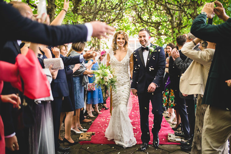 Bride Bridal Veil Dress Gown Embellished Fishtail Moss Bros Groom Navy Dinner Jacket Tuxedo Bow Tie Confetti Shot Gold Sequins Marble Greenery Vintage Glamour Wedding https://www.tobiahtayo.com/
