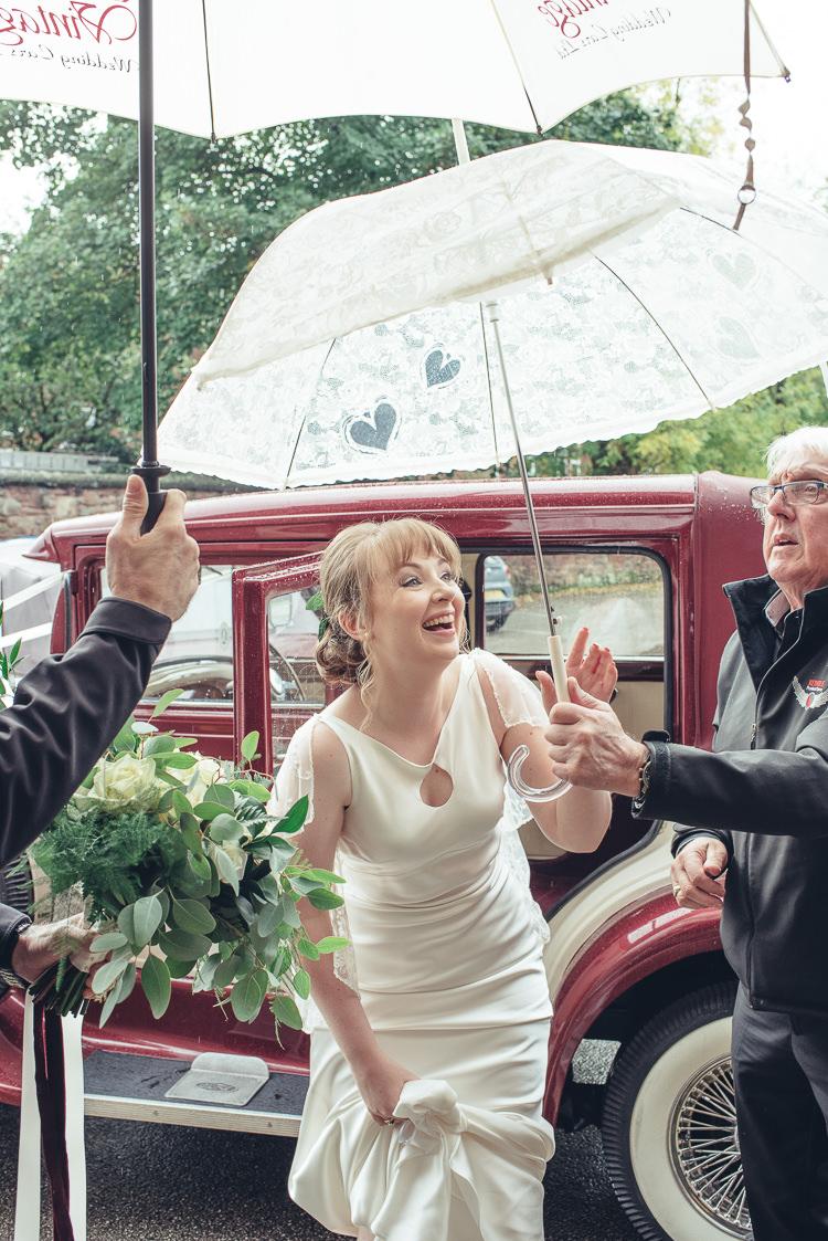 Bride Dress Caped Silk Keyhole September Rain Umbrella Red Vintage Car | Greenery Burgundy City Autumn Wedding http://lisahowardphotography.co.uk/