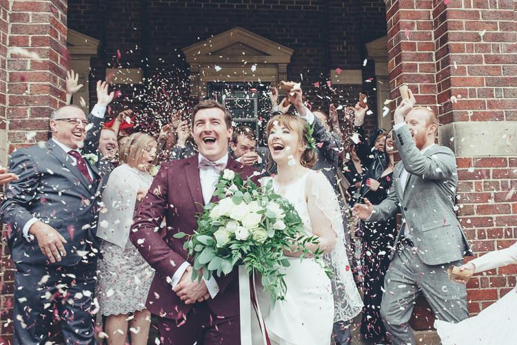 Bride Groom Confetti Shot After Ceremony Church Happy Family Burgundy Suit Wild Foliage Bouquet | Greenery Burgundy City Autumn Wedding http://lisahowardphotography.co.uk/