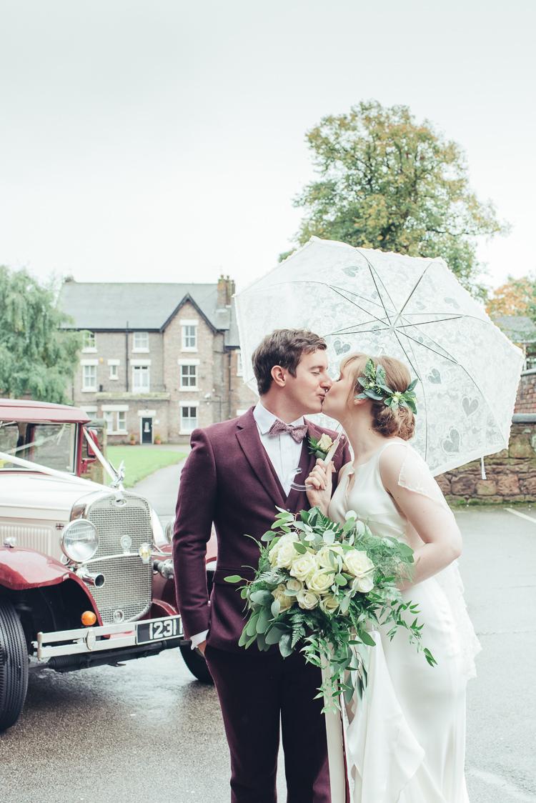 Bride Groom Kiss After Ceremony Under Umbrella Wild Foliage Bouquet | Greenery Burgundy City Autumn Wedding http://lisahowardphotography.co.uk/