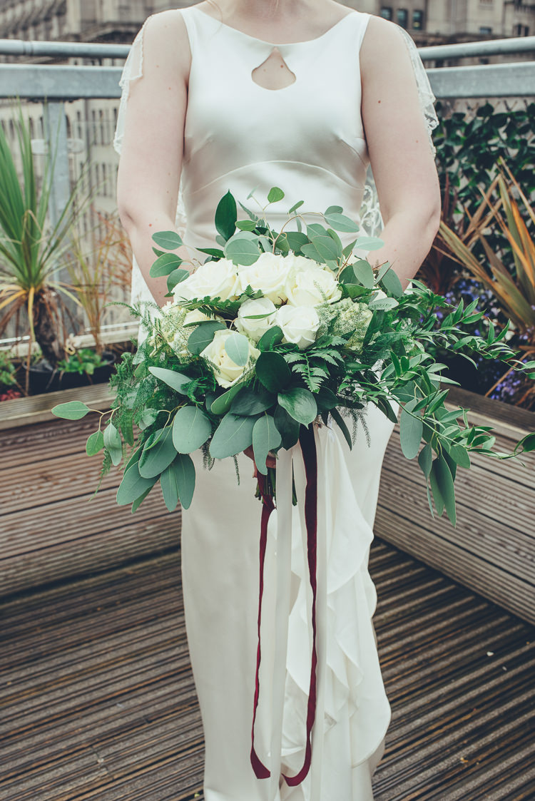 Bride Caped Silk Dress Wild Foliage White Bouquet Ribbon Relaxed Industrial | Greenery Burgundy City Autumn Wedding http://lisahowardphotography.co.uk/