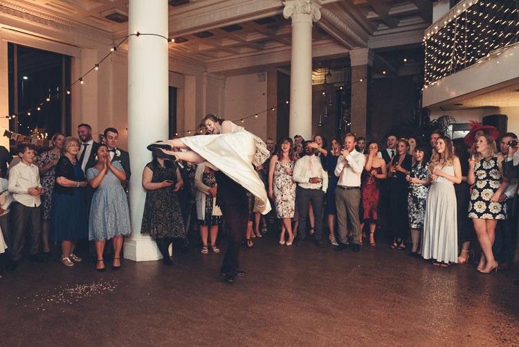 Bride Groom Funny First Dance Fast Twirl Lift Fairy Lights Indoor Reception | Greenery Burgundy City Autumn Wedding http://lisahowardphotography.co.uk/