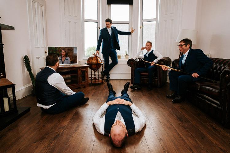 Groom Groomsmen Waiting Funny Navy Suits | Glitter Dinosaurs City Wedding https://struvephotography.co.uk/