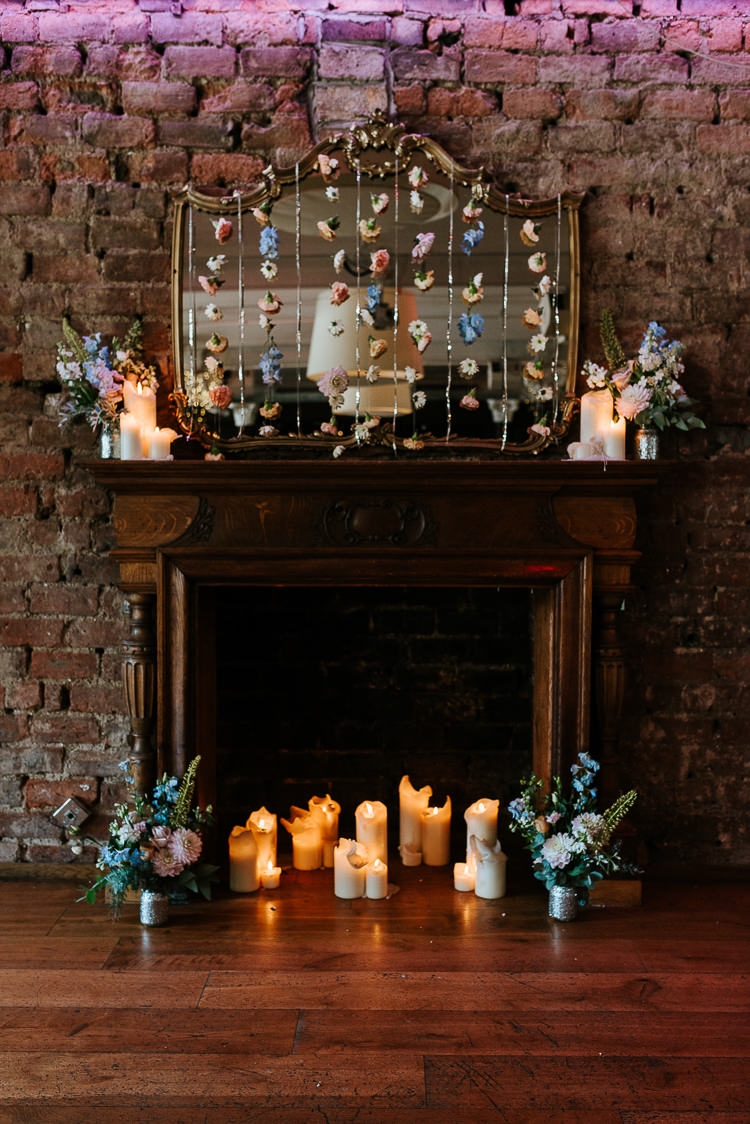 Hanging Floral Curtain Mantlepiece Installation Candles Flowers | Glitter Dinosaurs City Wedding https://struvephotography.co.uk/