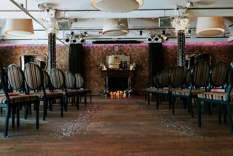 Hanging Floral Curtain Glitter Aisle Ceremony Backdrop | Glitter Dinosaurs City Wedding https://struvephotography.co.uk/