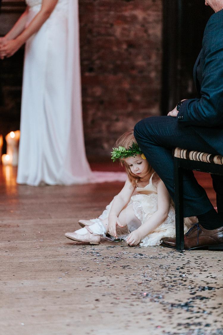 Adorable Cute Flower Girl Crown Floor Glitter Ceremony Aisle | Glitter Dinosaurs City Wedding https://struvephotography.co.uk/