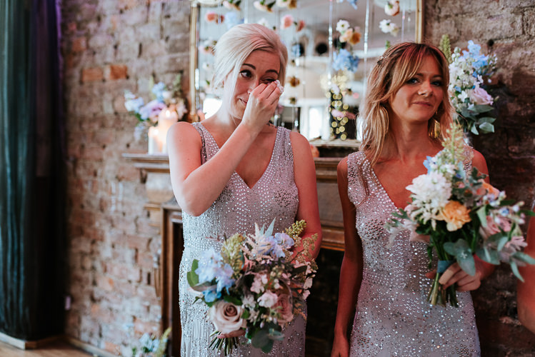 Silver Sequin Bridesmaid Dresses Colorful Pastel Bouquets Flower Curtain | Glitter Dinosaurs City Wedding https://struvephotography.co.uk/