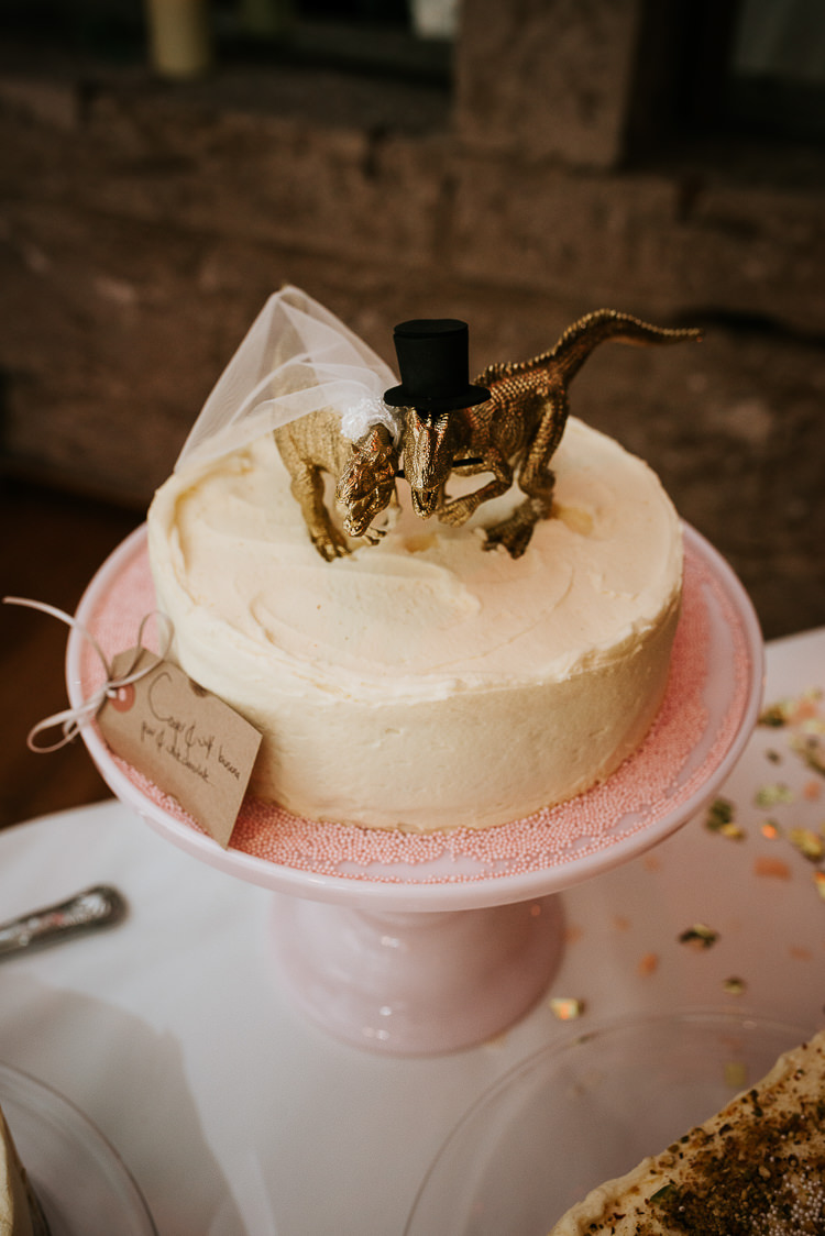 Gold Dinosaur Cake Topper Alternative Theme Quirky | Glitter Dinosaurs City Wedding https://struvephotography.co.uk/