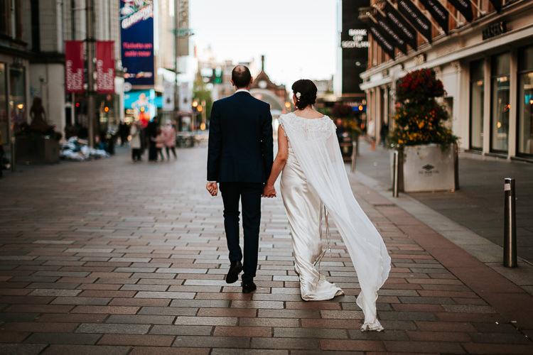 Bride Groom Walk City Street Photography Glasgow Scotland Cape Dress | Glitter Dinosaurs City Wedding https://struvephotography.co.uk/