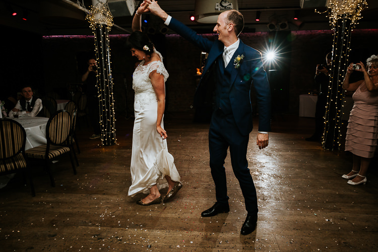 Bride Groom First Dance Urban Quirky Fun Glitter Fairy Lights | Glitter Dinosaurs City Wedding https://struvephotography.co.uk/