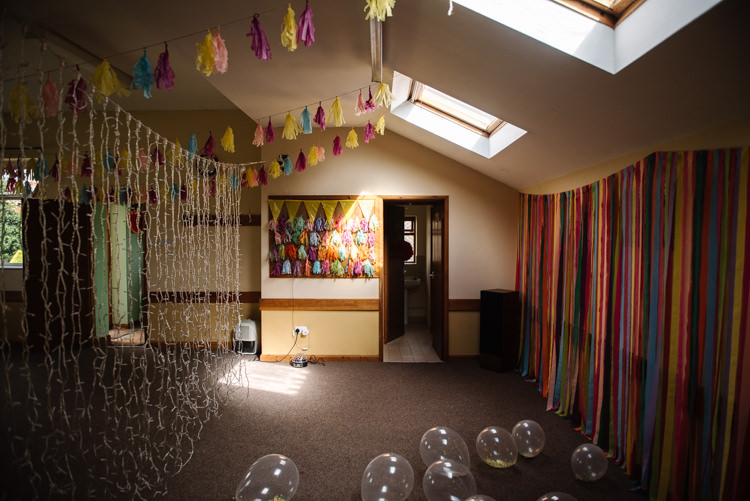 Village Hall Streamers Pea Light Curtain Fairy Pom Poms Balloons Homemade Street Party Back Garden Wedding http://www.foxmoonphotography.com/