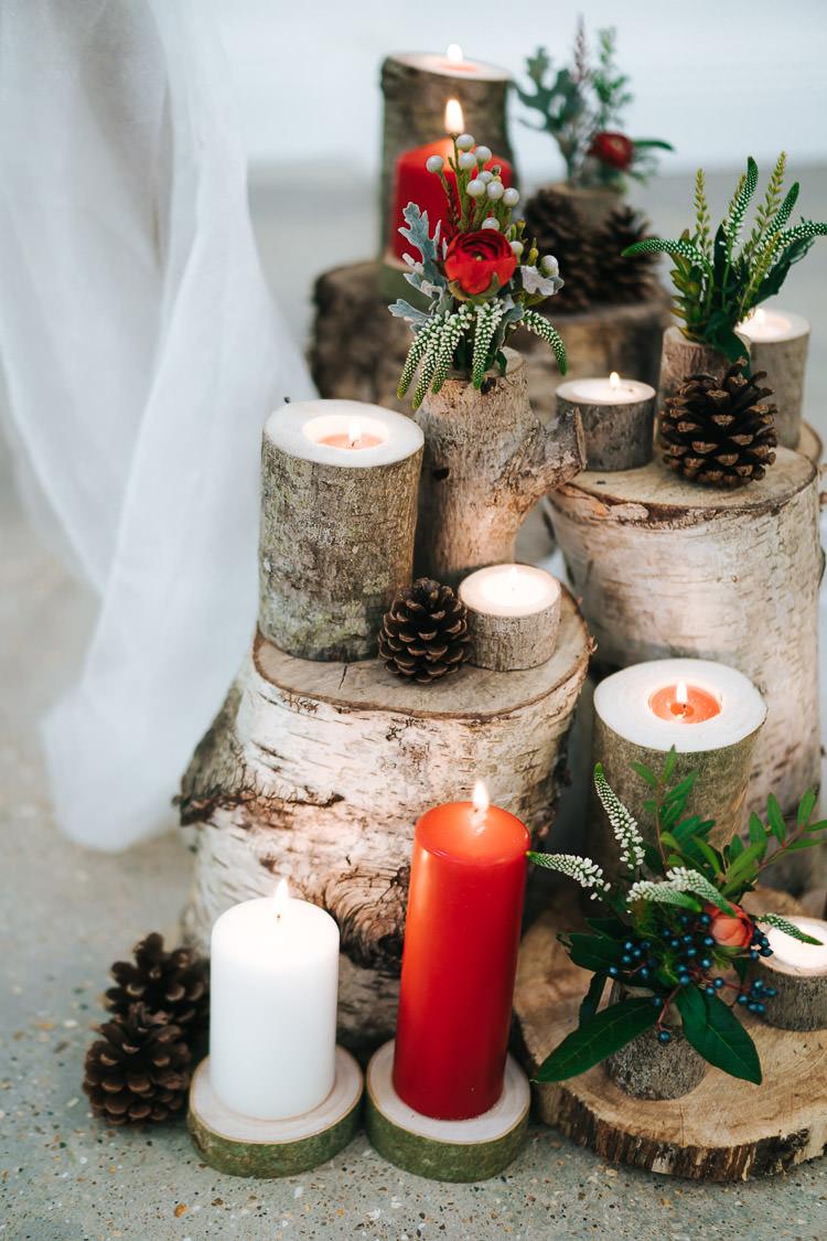 Tree Stump Log Decor Candles Flowers Pine Cones Red Green Winter Wonderland Wedding Ideas http://www.angelawardbrown.com/