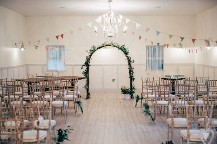 Vintage Bunting Foliage Floral Arch Ceremony Old Fashioned Fete Cricket Pavilion Wedding https://www.naomijanephotography.com/