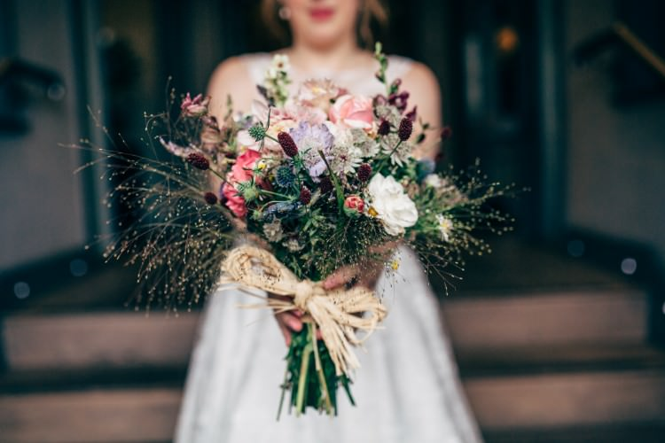Bride Bridal Wildflower Meadow Grasses Raffia Thistle Bouquet Old Fashioned Fete Cricket Pavilion Wedding https://www.naomijanephotography.com/