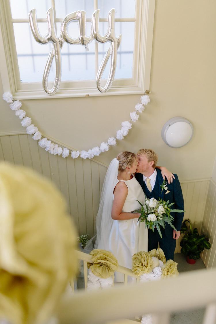 The Tab Centre Shoreditch Paper Pompom Garland Silver Yay Balloon London Urban Bride Groom Kiss | Modern Tropical Gold Urban Wedding https://www.christinewehrmeier.com/
