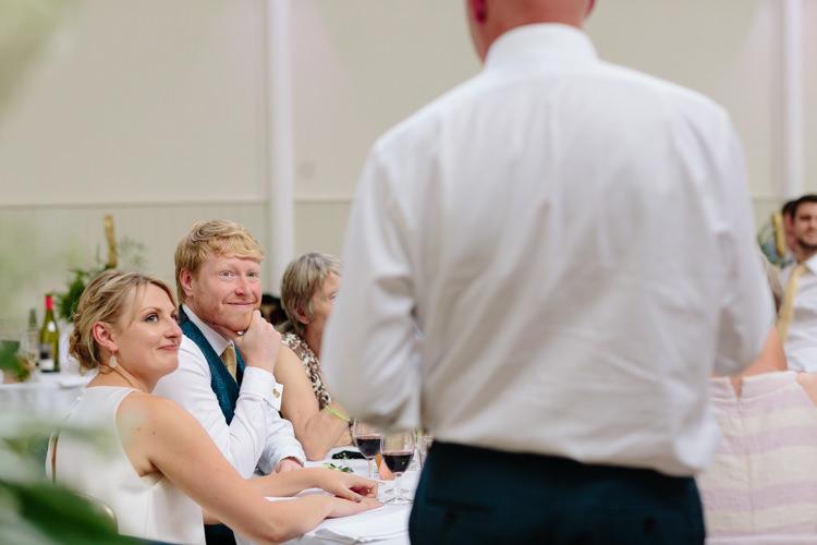 Bride Groom Speeches Smiling Happy Wedding Guest | Modern Tropical Gold Urban Wedding https://www.christinewehrmeier.com/
