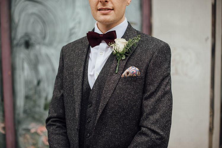 Groom Three Piece Suit Waistcoat Grey Tweed Burgundy Bow Tie Pocket Square Chic Relaxed London Pub Wedding https://theshannons.photography/