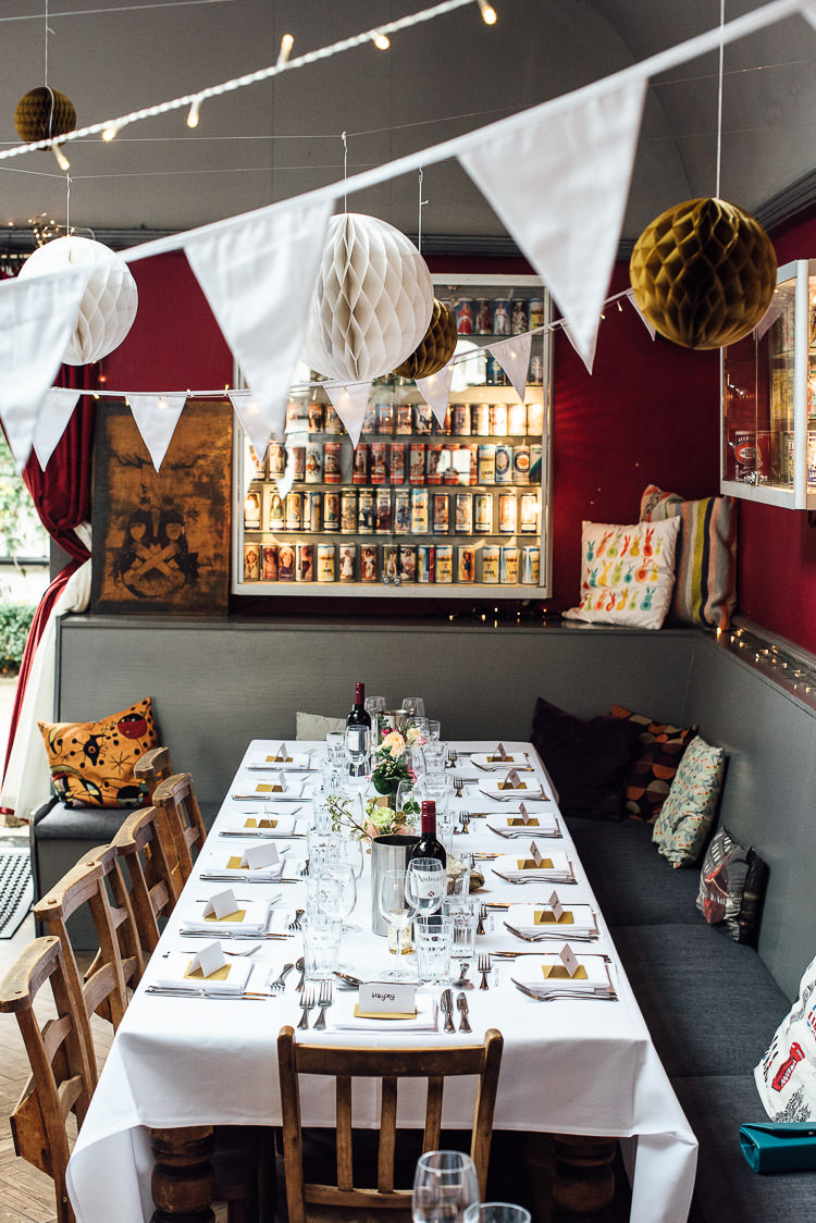 Bunting Fairy Lights Paper Lanterns Table Setting Chic Relaxed London Pub Wedding https://theshannons.photography/