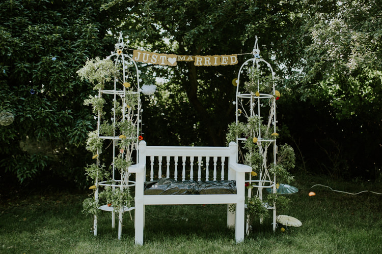 Field Outdoor Garden Tipi Hippie Just Married Flower Arch | Happy Outdoor Forest Mustard Yellow Wedding http://suzi-photography.com/