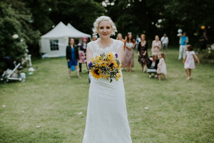 Field Garden Woodland Meadow Hippie Summer Bride Sunflower Bouquet Toss Hush Venue | Happy Outdoor Forest Mustard Yellow Wedding http://suzi-photography.com/