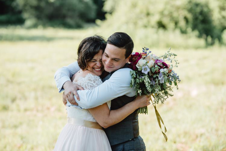 Outdoor Field Forest Wild Nature Marquee Tipi Bride Groom Bouquet Happy Embrace | Breathtaking Secluded Back Garden Open Sided Tent Wedding Vermont https://kickasscouples.com/